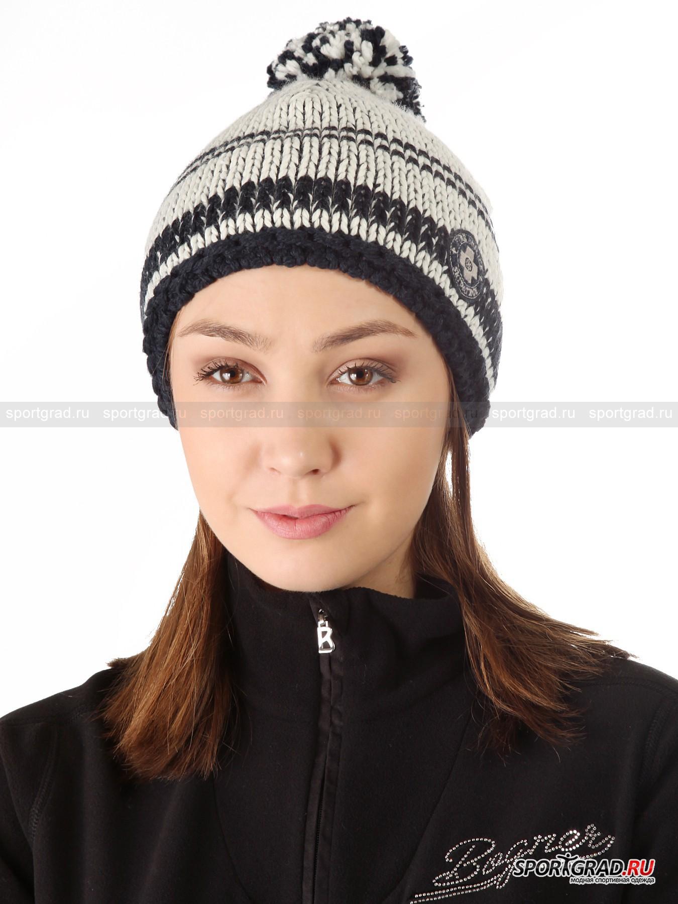 Шапка женская вязаная  Marly BOGNER с флисовой вставкой изнутриГоловные Уборы<br>Сбоку декорированная нашивкой шапка Marly BOGNER с помпоном. Фактурная вязка, рельефная «резинка» по низу и флисовая влагоотводящая вставка изнутри – изделие создано защищать от холодного ветра в городе и на склоне. Расцветку модели уточняйте у оператора.<br><br>Ширина флисовой вставки 6, 5 см, диаметр окружности 25 см (размер L).<br><br>Пол: Женский<br>Возраст: Взрослый<br>Тип: Головные Уборы<br>Рекомендации по уходу: Изделию показана машинная стирка при температуре строго 30°, глажка при температуре, не превышающей 110°, и щадящая химчистка. Запрещены отбеливание и сушка в барабане или электросушилке для белья.<br>Состав: Основное изделие: 50% шерсть, 50% поликарил. Подкладка: 100% полиэстер.