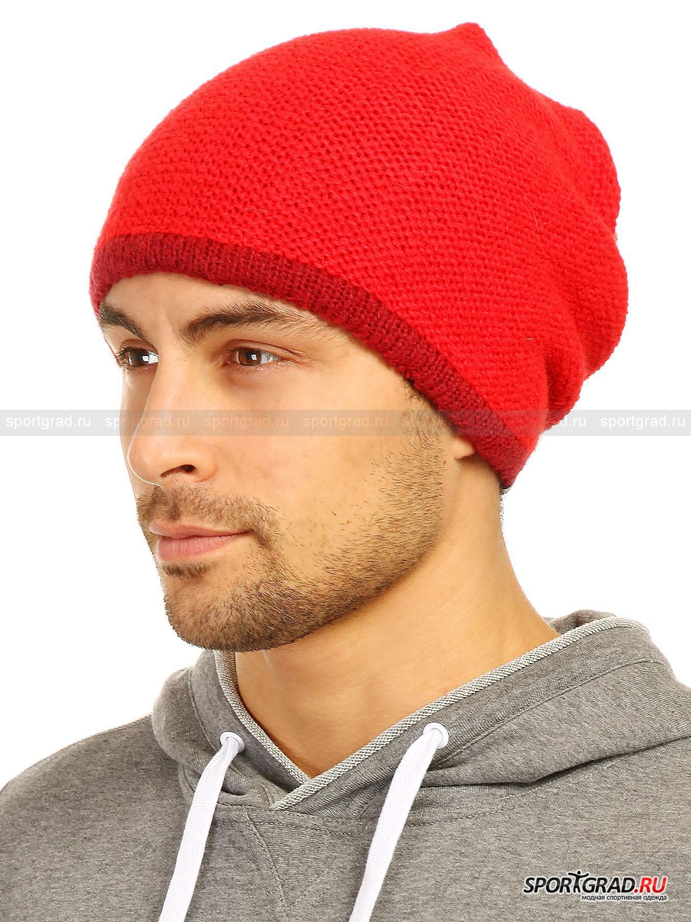 Шапка вязаная унисекс МееtingГоловные Уборы<br>Оригинальная объемная шапка Meeting универсальна и подойдет как мужчинам, так и женщинам. Она состоит из двух слоев полотна, связанного «изнаночными» петлями – сверху ярко-красного, а изнутри бордового цвета, такого же, как окантовка по периметру. Верхняя часть шапки имеет отверстие с красиво собранной вокруг него тканью.<br><br>Модель обладает увеличенной длиной и садится свободно, не обхватывая голову слишком плотно. Стильная молодежная вещь для ярких образов, которая к тому же отлично согревает.<br><br>Возраст: Взрослый<br>Тип: Головные Уборы<br>Рекомендации по уходу: ручная стирка; не отбеливать; гладить слегка нагретым утюгом (температура до 110 C); только сухая чистка; нельзя выжимать и сушить в стиральной машине<br>Состав: 42% полиакрил, 30% мохер, 28% полиамид