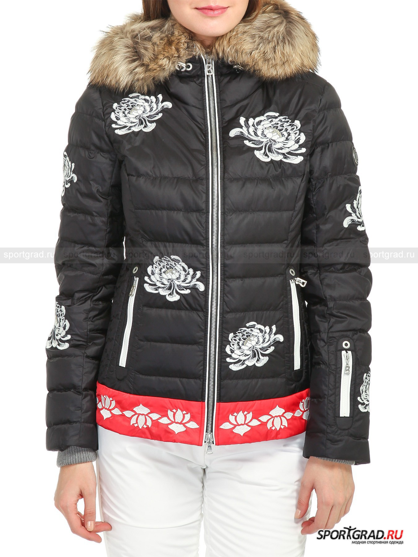 Пуховик горнолыжный женский Leya-d BOGNERКуртки<br>Женская горнолыжная куртка Leya-d BOGNER с коралловым бордюром и подкладкой капюшона в тон – расшитая непальскими цветами модель: легкая, будто перышко, благодаря наполнителю из гусиного пуха и замечательно сидящая на фигуре за счет продуманной конструкции рельефных швов спереди и сзади. <br><br>Модель имеет:<br>- составляющий с воротником-стойкой единое целое капюшон с корректирующим ширину просвета эластичным шнуром на фиксаторе;<br>- потайные манжеты из плотного двойного трикотажа, страхующие от попадания внутрь холодных потоков воздуха и снега;<br>- двухзамковую центральную застежку на молнию с фирменным бегунком и внутренней защитной планкой;<br>- застегивающуюся спереди на кнопки «снежную» юбку на резинке с силиконовой тесьмой, препятствующей задиранию во время движения; <br>- пару прорезных карманов на поясе + кармашек под карточку для ски-пасса на левом рукаве;<br>- глубокий внутренний карман, снабженный зиппером;<br>- комбинированную клетчатую подкладку с эффектными нашивками, воплощающими символику коллекции;<br>- петлю для вешалки и фирменную фурнитуру.<br>Длина рукава по внутреннему шву без учета манжет ок. 60, 5 см, длина сзади по центру от горловины до низа 47, 5 см, ширина груди 48, 5 см, ширина по бедрам 49 см (размер 36).<br><br>Пол: Женский<br>Возраст: Взрослый<br>Тип: Куртки<br>Рекомендации по уходу: Изделию показана стирка при температуре строго 30°, глажка при температуре, не превышающей 110°, щадящая сушка, профессиональная хим- и аквачистка. Запрещено отбеливание.<br>Состав: Поверхность: 100% полиамид. Подкладка: 100% полиэстер. Наполнитель: 80% гусиный пух, 20% перо. Опушка: мех дикой куницы.