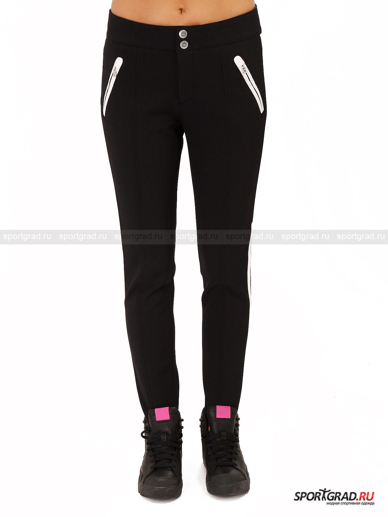 Брюки женские BOGNER LiliБрюки<br>Спортивная одежда немецкой компании Bogner считается передовой не только в области практичности, но и стиля. <br><br>Невероятно комфортные женские брюки Lili отлично подойдут для катания на коньках солнечными зимними днями. Эластичная основа  и уплотненная структура обеспечат долговечность ткани, благодаря чему ни одно падение не сможет сказаться на материале. Брюки великолепно сидят на теле и не сковывают движения. Подойдут они и для катания на лыжах, когда приятная зимняя погода обходится без сильных морозов.<br><br>•Застегиваются на двойной крючок и молнию<br>•Передние карманы на молнии<br>•Манжеты штанин венчают эластичные пятки для лучшей фиксации на ноге<br>•Контрастная отделка карманов и лампас штанин<br><br>Пол: Женский<br>Возраст: Взрослый<br>Тип: Брюки<br>Рекомендации по уходу: Деликатная стирка при 30С, не отбеливать, не сушить в барабане стиральной машины, гладить при температуре 110С, химчистка запрещена.<br>Состав: 48% полиамид/47% вискоза/5% эластан.