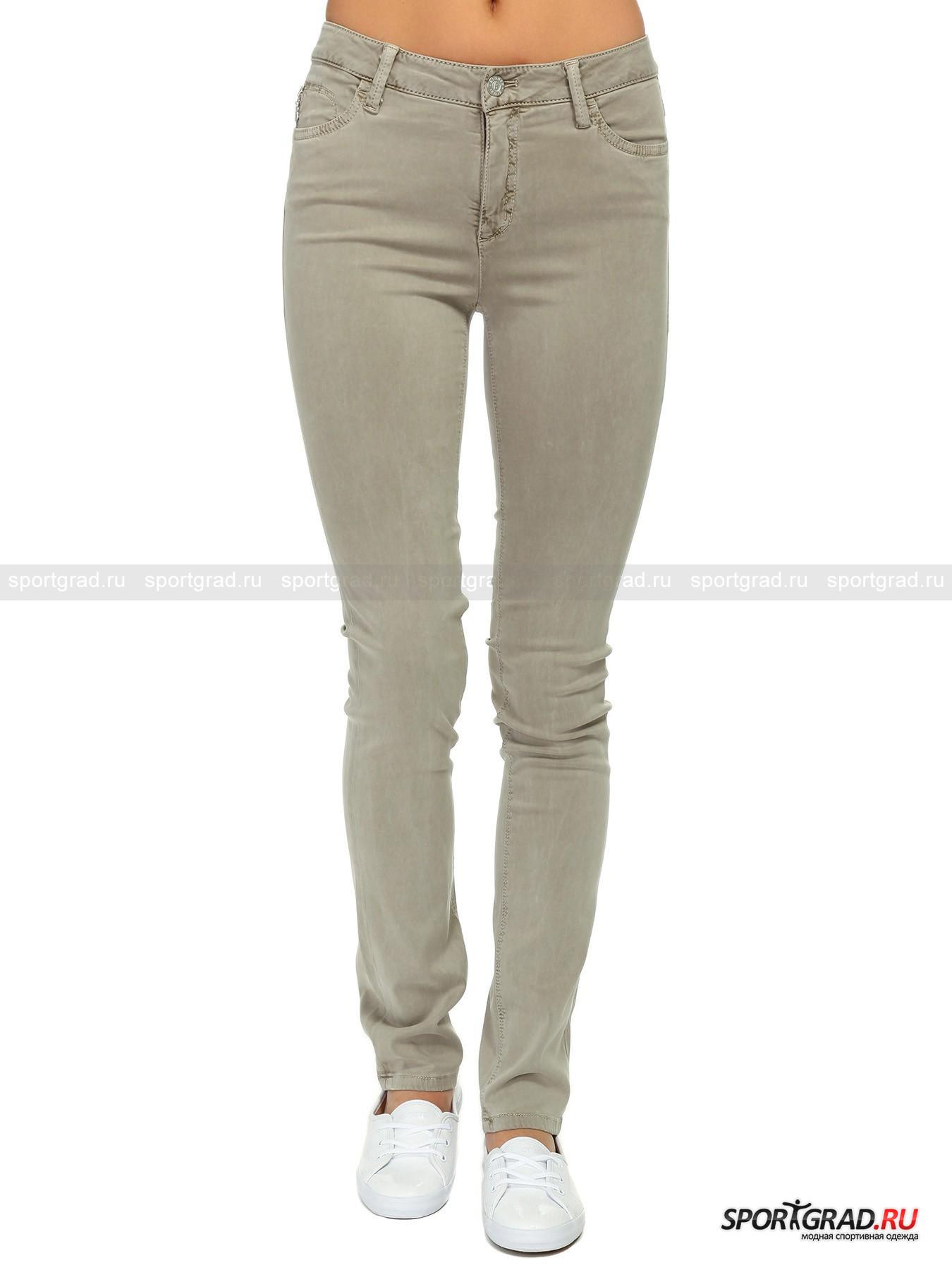 Джинсы женские BOGNER JEANS Supershape SlimБрюки<br>Коллекции немецкого бренда Bogner Jeans безусловно полны различных моделей качественных и стильных джинсов разного кроя и посадки.<br><br>Supershape Slim – зауженные джинсы классического силуэта. Привычные 5 карманов, один из которых (скрытый) на молнии. Наличие эластана обеспечивает ткань тянущимся свойством, позволяющим сохранять внешний вид модели даже после стирки. Наличие материала лиоцелла гарантирует повышенный уровень износоустойчивости и долговечности.<br><br>•Застегиваются на металлическую пуговицу и молнию<br>•Шлевки под ремень<br>•Зауженный после колена крой<br>•Фирменный логотип компании сзади в районе талии<br><br>Пол: Женский<br>Возраст: Взрослый<br>Тип: Брюки<br>Рекомендации по уходу: Деликатная стирка при 30С, не отбеливать, не сушить в барабане стиральной машины, гладить при температуре не более 110С, химчистка запрещена.<br>Состав: 64% лиоцелл/ 34% хлопок/2% эластан.