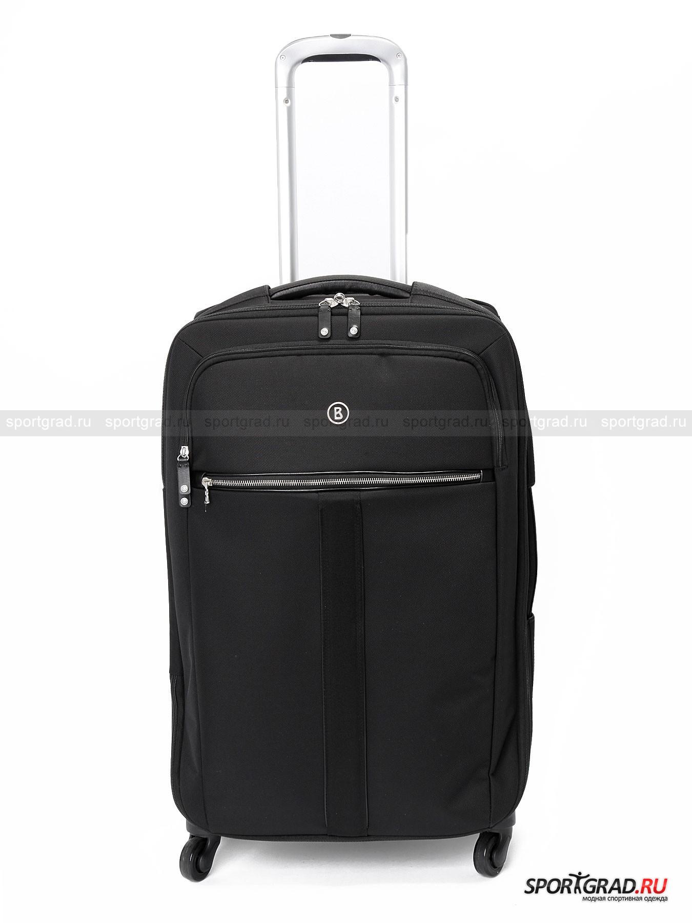 Чемодан Travel Spinner М BOGNERСумки<br>Чемодан для путешествий следует выбирать с особой тщательностью, ведь от него во многом зависит комфорт в поездке. Он должен быть не только достаточно большим, но также практичным, прочным и продуманным. Все это в полной мере относится к чемодану Travel Spinner M Bogner.<br><br>Эта вместительная  модель сделана из прочного и износостойкого нейлона, устойчивого к повреждениям. Основное отделение снабжено ремнями для фиксации вещей, если это нужно, и карманом-сеточкой на молнии с внутренней стороны крышки. Также имеется еще одно отделение поменьше с двумя внутренними карманами и одним наружным на молнии.<br><br>Другие особенности модели:<br>- четыре колеса, способных поворачивать на 360 градусов;<br>- сверху и на боку ручки с кожаной вставкой анатомической формы изнутри;<br>- выдвигающаяся металлическая ручка;<br>- фирменный логотип.<br><br>Возраст: Взрослый<br>Тип: Сумки<br>Рекомендации по уходу: Нельзя стирать, отбеливать, гладить, сушить в машинке. Химчистка запрещена. Хранить в темном сухом месте, предварительно набив бумагой.<br>Состав: Материал верха 100% нейлон