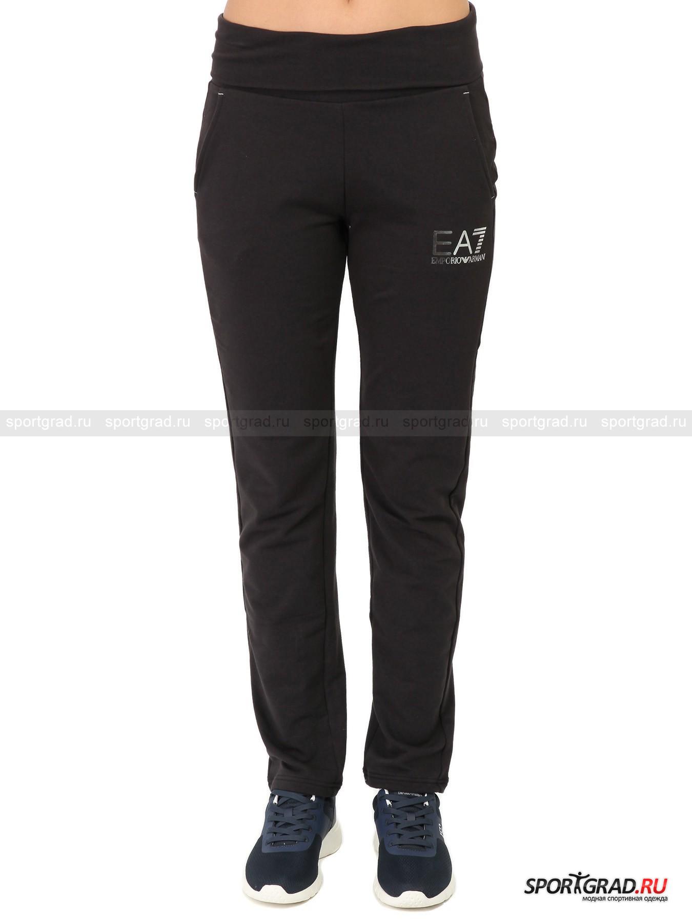 Брюки женские Train Core Pants  EA7 Emporio ArmaniБрюки<br>Спортивная одежда из линии EA7 Emporio Armani - выбор энергичных и успешных людей. Фантастическое качество и оригинальный стиль вещей марки подкупает с первого взгляда и прикосновения,  а непревзойденный комфорт гарантирует, что после примерки вы не захотите их снимать.<br>Удобные темно-серые брюки Train Core Pants предназначены для двигательной активности на улице или в прохладном помещении. Классическая модель для модных девушек, выбирающих самое лучшее.<br><br>Особенности модели:<br>-пояс на резинке;<br>-два кармана по бокам;<br>-гладкая изнанка;<br>-прямой крой;<br>-серебристый блестящий логотип EA7.<br><br>Пол: Женский<br>Возраст: Взрослый<br>Тип: Брюки<br>Рекомендации по уходу: стирка в теплой воде до 30 С; не отбеливать; гладить слегка нагретым утюгом (температура до 110 C); химическая чистка запрещена; нельзя выжимать и сушить в стиральной машине<br>Состав: 65% хлопок, 30% полиэстер 5% эластан
